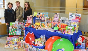Image of NBSB with toys collected through the North Brookfield Savings Bank Annual Toy Drive.