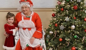 Image of boy with Mrs. Claus
