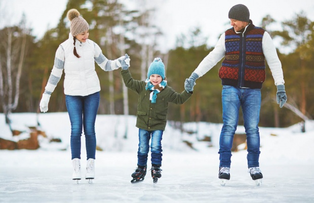 Two parents ice skating with son.
