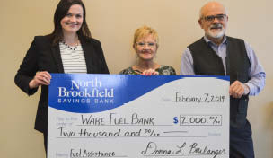 Photo of Ware Fuel Bank check being presented.