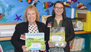 Patty Ostrout and Rachael Slozak Show off the books they read to Warren Community Elementary School Students