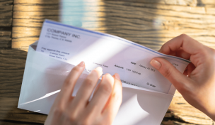 image of someone opening paycheck