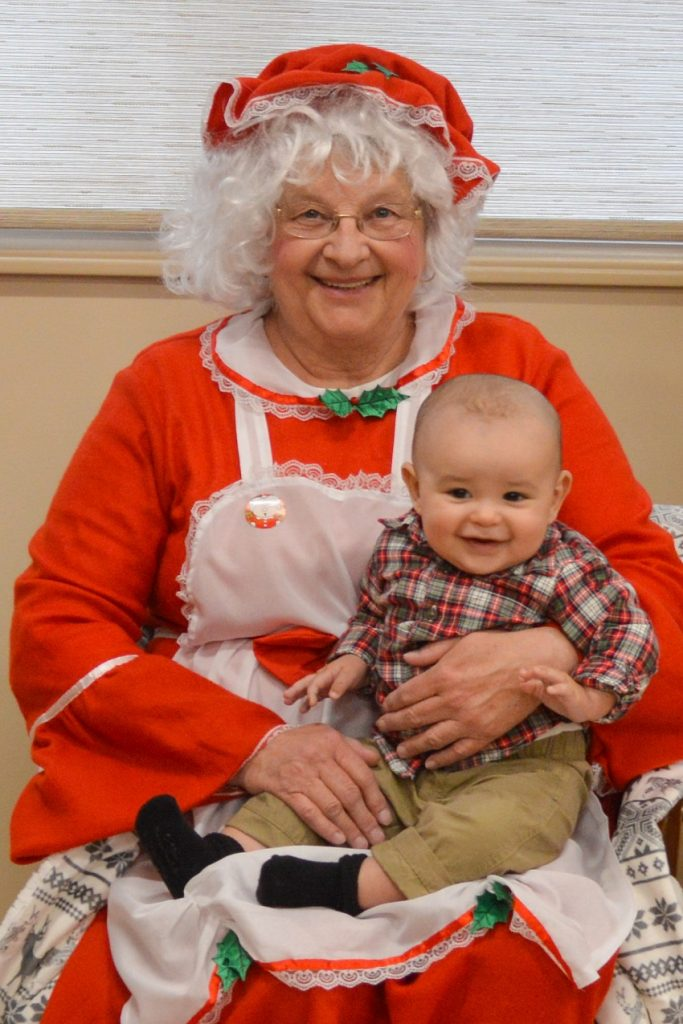 Photo: Levi Brown, along with his mother Rachael Slozak, visited the North Brookfield Savings Bank White Christmas Open House last year to have a photo with Mrs. Santa Claus. The West Brookfield Branch also featured a fun craft station, delicious holiday treats, goodie bags, a drawing and Santa's elves!