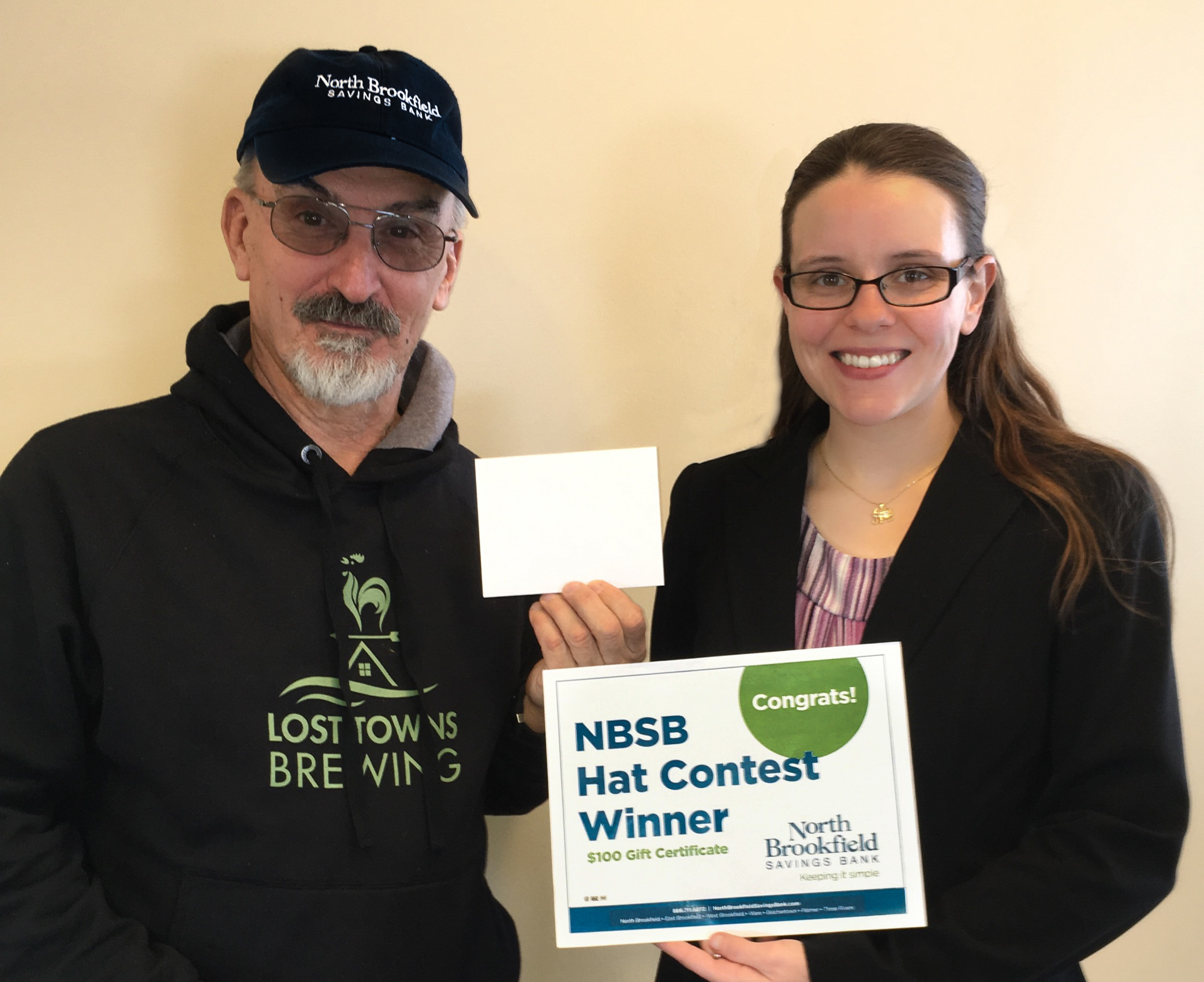 North Brookfield Savings Bank's Ware Supervisor and Marketing Assistant Nicole Syriac presented a $100 Lost Towns Brewing gift certificate to NBSB's January Hat Contest Winner Joseph Siok.